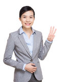 Business woman show three finger Stock Photo