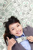 Business woman show thumb up with money Stock Image