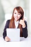 Business woman show thumb up and using tablet pc Royalty Free Stock Image