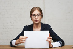 Business woman show white paper Stock Photo