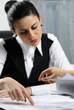 Business woman showing. Business woman interviewing people for jobs in office Stock Photo