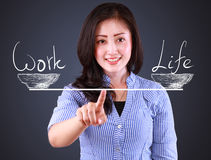 Business woman showing balancing concept Royalty Free Stock Image
