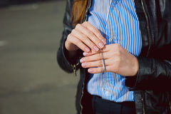 Business Woman showing beautiful silver necklace. Closeup hands. Concept of luxurious and wealth life stock images