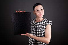 A business woman showing a black board Stock Photos