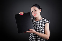 A business woman showing a black board Royalty Free Stock Images