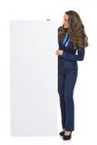 Business woman showing blank billboard Stock Image
