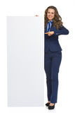 Business woman showing blank billboard Stock Photography