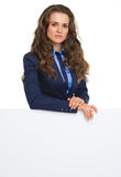 Business woman showing blank billboard Stock Image