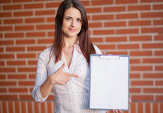 Business woman showing blank clipboard Stock Photo