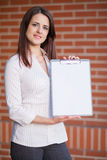 Business woman showing blank clipboard Royalty Free Stock Image