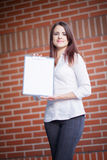 Business woman showing blank clipboard Stock Image