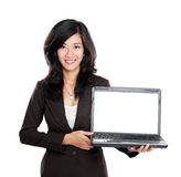 Business woman showing blank laptop screen Royalty Free Stock Image