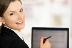 Business woman showing blank laptop screen ready for text. Business woman showing laptop screen ready for text. Presentation and beautiful woman Royalty Free Stock Images