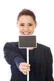 Business woman showing blank signboard Stock Photo