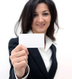 Business woman showing a business card. Isolated over white background Royalty Free Stock Images