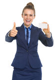 Business woman showing business card and thumbs up Royalty Free Stock Photo