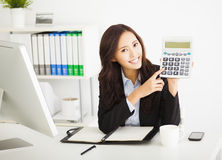 business woman showing the calculator in office Stock Images