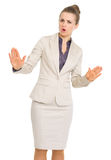 Business woman showing calm down gesture. Isolated on white stock photos
