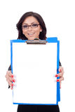 Business woman showing clipboard. Young business woman showing clipboard against studio background Stock Image