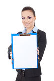 Business woman showing clipboard. Young business woman showing clipboard with smile on her face against white background Stock Images