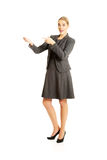 Business woman showing copy space on the left Royalty Free Stock Photo