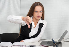 Business woman showing dislike sign Royalty Free Stock Photo