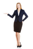 Business woman showing empty space on her palm. Stock Photo