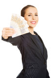 Business woman showing euro currency money. Stock Photography
