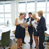 Business woman showing files to team Royalty Free Stock Photo