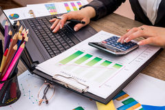 Business woman showing financial charts with laptop Royalty Free Stock Image