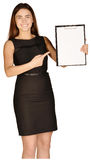 Business woman showing forefinger on clipboard Stock Image