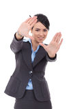 Business woman showing framing hand gesture Stock Images