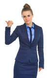 Business woman showing get out gesture Stock Photos