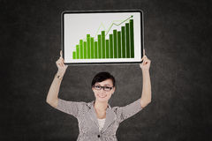 Business woman showing growth graph Stock Photos