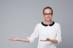 Business woman showing hand sign to side. Royalty Free Stock Photography