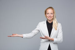 Business woman showing hand sign to side. Royalty Free Stock Image