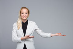 Business woman showing hand sign to side. Stock Images