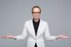 Business woman showing hands sign to sides. Royalty Free Stock Image