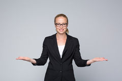 Business woman showing hands sign to sides. Stock Images