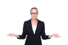 Business woman showing hands sign to sides. Royalty Free Stock Photos