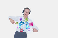 Business woman showing icons and wearing Headset Stock Photos