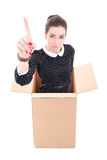 Business woman showing idea gesture in cardboard box isolated on Stock Photo