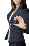 Business woman showing the key Royalty Free Stock Photography
