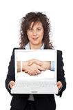 Business woman showing a laptop. Over a white background Royalty Free Stock Images