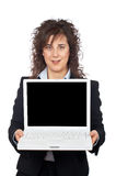 Business woman showing a laptop. Over a white background Royalty Free Stock Photo