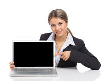 Business woman showing a laptop screen Stock Image