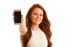Business woman showing a message on a screen of a smart phone is Stock Photography