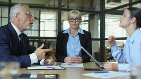 Business woman showing no idea gesture, emotional colleagues shouting in office stock video