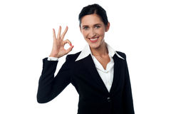 Business woman showing ok gesture Royalty Free Stock Photo