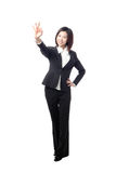 Business woman showing OK hand in full length Stock Image